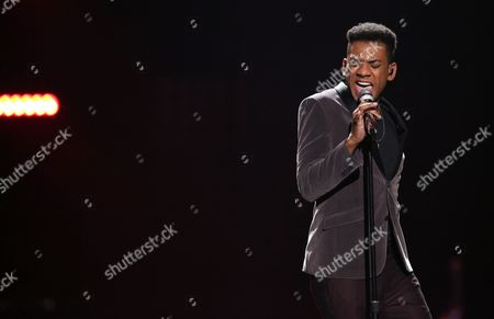 """Joshua Ledet performs at the """"American Idol"""" farewell season finale at the Dolby Theatre, in Los Angeles"""