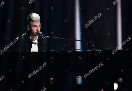 """Colton Dixon performs at the """"American Idol"""" farewell season finale at the Dolby Theatre, in Los Angeles"""