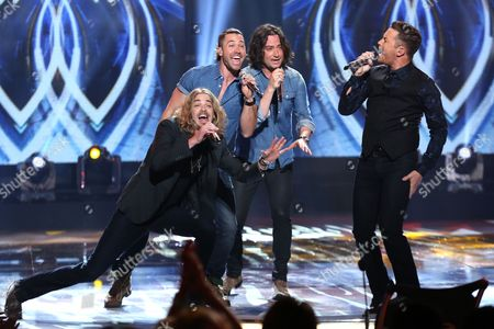 """Bucky Covington, from left, Ace Young, Constantine Maroulis and Scotty McCreery perform at the """"American Idol"""" farewell season finale at the Dolby Theatre, in Los Angeles"""