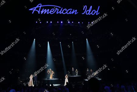 "Katherine McPhee, from left, Casey James, Carly Smithson, Jessica Sanchez, Clay Aiken, Ruben Studdard and Amber Holcomb perform at the ""American Idol"" farewell season finale at the Dolby Theatre, in Los Angeles"