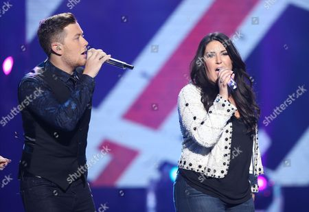 "Scotty McCreery, left, and Kree Harrison perform at the ""American Idol"" farewell season finale at the Dolby Theatre, in Los Angeles"