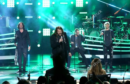 "Constantine Maroulis, from left, Caleb Johnson, Bo Bice, and James Durbin perform at the ""American Idol"" farewell season finale at the Dolby Theatre, in Los Angeles"