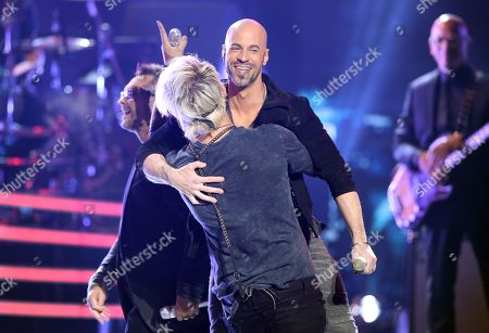 "James Durbin, left, and Chris Daughtry perform at the ""American Idol"" farewell season finale at the Dolby Theatre, in Los Angeles"