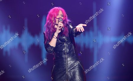 """Allison Iraheta performs at the """"American Idol"""" farewell season finale at the Dolby Theatre, in Los Angeles"""