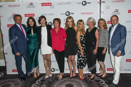 From left, Actors Hugh Bonneville, Michelle Dockery, Elizabeth McGovern, Penelope Wilton, Laura Carmichael, Joanne Froggatt, Masterpiece executive producer Rebecca Eaton, Masterpiece senior series producer Susanne Simpson and executive producer Gareth Neame attend the 'Downton Abbey' cast photo call during the 2015 Summer TCA Tour at The Beverly Hilton Hotel on in Beverly Hills, Calif
