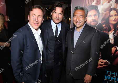 "Executive producer/screenwriter/novel author Jonathan Tropper, and from left, Jason Bateman and Kevin Tsujihara, chief executive officer of Warner Bros., arrive at the Los Angeles premiere of ""This Is Where I Leave You"" at the TCL Chinese Theatre on"