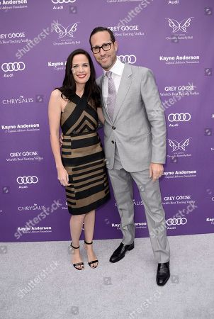 Honoree and President of Chernin Entertainment Katherine Pope, left, and talent agent Richard Weitz arrive at the 12th Annual Chrysalis Butterfly Ball on in Los Angeles