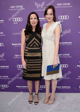 Actress Dakota Johnson, right, and honoree and President of Chernin Entertainment Katherine Pope arrive at the 12th Annual Chrysalis Butterfly Ball on in Los Angeles