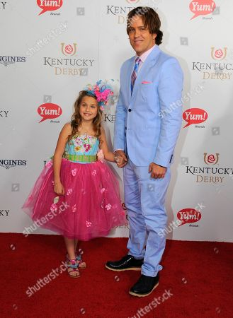 Larry Birkhead, right, and his daughter Dannielynn are photographed at the 140th Kentucky Derby in Louisville Ky
