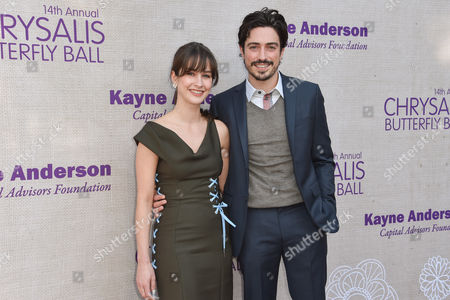 Michelle Mulitz, left and Ben Feldman arrive at the 14th Annual Chrysalis Butterfly Ball held at the residence of Susan Harris and Hayward Kaiser, in Los Angeles