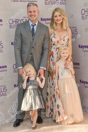 Eric Dane, from left, Georgia Dane, Rebecca Gayheart-Dane, and Billie Beatrice Dane arrive at the 14th Annual Chrysalis Butterfly Ball held at the residence of Susan Harris and Hayward Kaiser, in Los Angeles