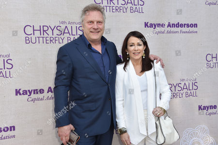 David Hunt, left, and Patricia Heaton arrive at the 14th Annual Chrysalis Butterfly Ball held at the residence of Susan Harris and Hayward Kaiser, in Los Angeles