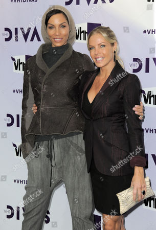 Stock Photo of Nicole Mitchell Murphy, left, and Jessica Canseco arrive at VH1 Divas, at the Shrine Auditorium in Los Angeles