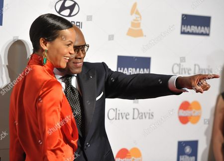 Music producer and honoree Antonio 'L.A.' Reid, right, and Erica Reid arrives at the Clive Davis Pre-GRAMMY Gala on in Beverly Hills, Calif