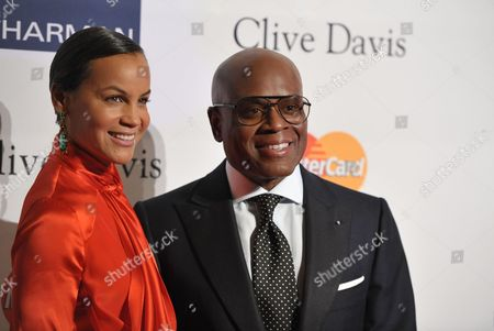 "Music producer and honoree Antonio ""L.A."" Reid, right, and Erica Reid arrive at the Clive Davis Pre-GRAMMY Gala on in Beverly Hills, Calif"
