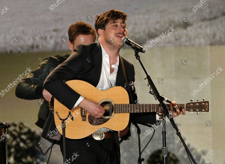 Marcus Mumford performs a tribute to Levon Helm at the 55th annual Grammy Awards, in Los Angeles