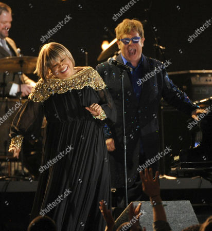 Stock Image of Mavis Staples, left, and Elton John perform a tribute to Levon Helm at the 55th annual Grammy Awards, in Los Angeles
