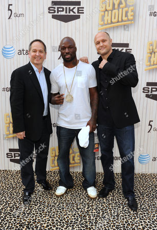 Kevin Kay, left, president of Spike TV, Muhammed Lawal, center, and Jimmy Smith arrive at Spike TV's Guys Choice Awards at Sony Pictures Studios, in Culver City, Calif