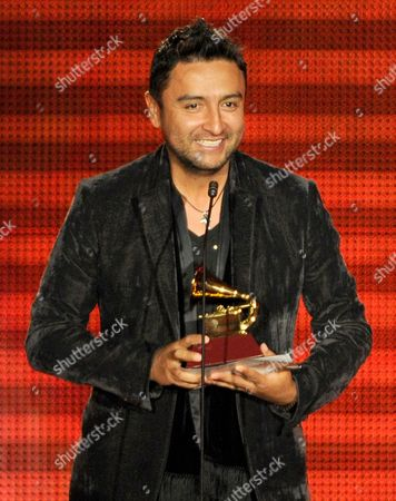 """Alex Campos accepts the award for best Christian album (Spanish language) for """"Regreso a Ti"""" at the 14th Annual Latin Grammy Awards at the Mandalay Bay Hotel and Casino, in Las Vegas"""