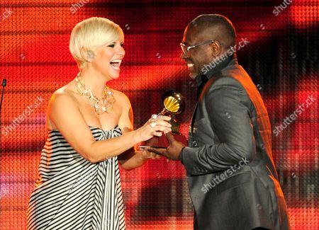 "Pasion Vega, left, presents the award for best christian album (Portugese language) to Kleber Lucas for ""Profeta Da Esperanca"" at the 14th Annual Latin Grammy Awards at the Mandalay Bay Hotel and Casino, in Las Vegas"