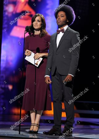 Julieta Venegas, left, and Alex Cuba present the award for song of the year at the 14th Annual Latin Grammy Awards at the Mandalay Bay Hotel and Casino, in Las Vegas