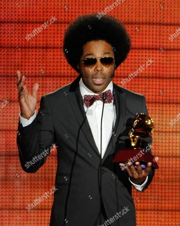 "Alex Cuba accepts the award for best short form music video for ""Eres Tu"" at the 14th Annual Latin Grammy Awards at the Mandalay Bay Hotel and Casino, in Las Vegas"