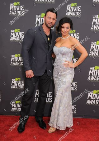 """Stock Picture of Roger Matthews, left, and Jenni """"Jwoww"""" Farley arrives at the MTV Movie Awards in Sony Pictures Studio Lot in Culver City, Calif., on"""
