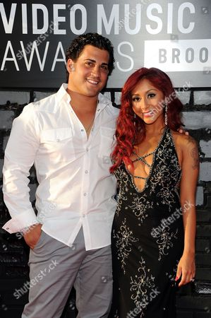 Nicole 'Snooki' Polizzi and Jionni LaValle arrives at the MTV Video Music Awards, at the Barclays Center in the Brooklyn borough of New York