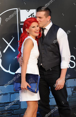 Carly Aquilino, left, and Chris Distefano arrive at the MTV Video Music Awards, at the Barclays Center in the Brooklyn borough of New York