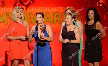 From left, Cara Hannah Sullivan, Bettie O. Rogers, Inga Thrasher and Jodi Mancuso accept the award for Outstanding Hairstyling for a Multi-Camera Series or Special for Saturday Night Live onstage at the 2013 Primetime Creative Arts Emmy Awards, on at Nokia Theatre L.A. Live, in Los Angeles, Calif