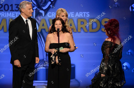 From left, Todd Kleitsch, Deborah Rutherford and Deborah Lamia Denaver accept the award for Outstanding Makeup for a Miniseries or a Movie (Non-Prosthetic) for Behind The Candelabra onstage at the 2013 Primetime Creative Arts Emmy Awards, on at Nokia Theatre L.A. Live, in Los Angeles, Calif