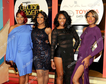 From left, singers Traci Braxton, Trina Braxton, Ashlee Braxton and Towanda Braxton arrive at the 2013 Soul Train Awards at the Orleans Arena on in Las Vegas