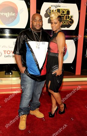 From left, LaShawn Daniels and April Daniels arrive at the 2013 Soul Train Awards at the Orleans Arena on in Las Vegas