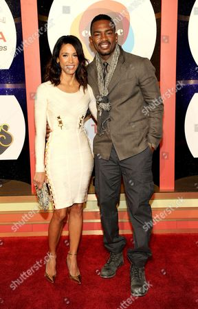 Actor/comedian Bill Bellamy, right, and actress Kristen Baker arrive at the 2013 Soul Train Awards at the Orleans Arena on in Las Vegas