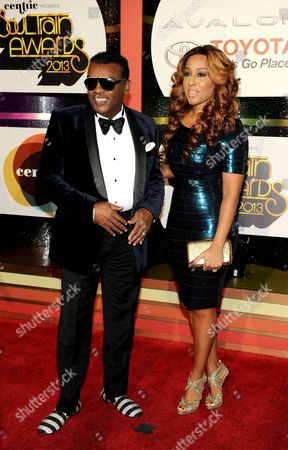 Stock Photo of Producer Ronald Isley, left, and Kandy Johnson Isley arrive at the 2013 Soul Train Awards at the Orleans Arena on in Las Vegas