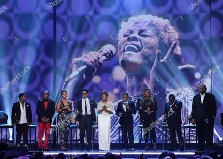 From left, Bobby V, Kenny Lattimore, Chrisette Michele, Eric Benet, Gladys Knight, Dionne Warwick, Ronald Isley, Candice Glover, Eddie Levert, Ruben Studdard, Debbie Allen and David Foster onstage at the 2013 Soul Train Awards at the Orleans Arena on in Las Vegas