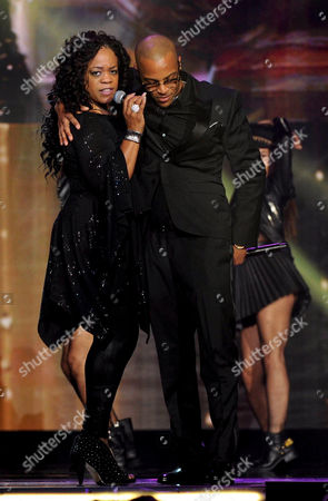 Evelyn 'Champagne' King, left, and T.I. perform onstage at the 2013 Soul Train Awards at the Orleans Arena on in Las Vegas
