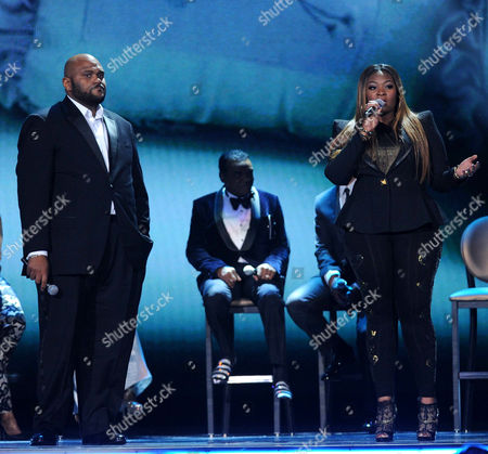 Ruben Studdard, left, and Candice Glover perform onstage at the 2013 Soul Train Awards at the Orleans Arena on in Las Vegas