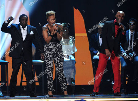 From left, Eddie Levert, Chrisette Michele and Kenny Lattimore perform onstage at the 2013 Soul Train Awards at the Orleans Arena on in Las Vegas