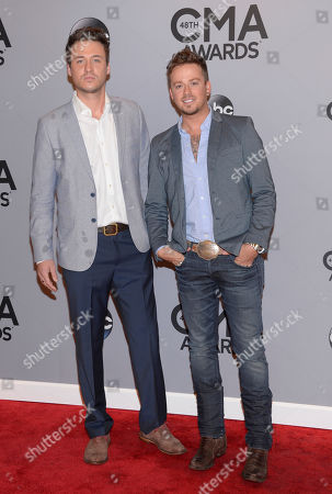 Stock Photo of Eric Gunderson, left, and Stephen Barker Liles, of the musical duo Love and Theft, arrive at the 48th annual CMA Awards at the Bridgestone Arena, in Nashville, Tenn