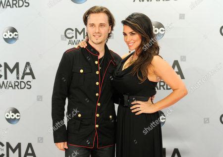 Jonathan Jackson, left, and Lisa Vultaggio arrive at the 48th annual CMA Awards at the Bridgestone Arena, in Nashville, Tenn