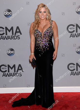 Rachel Holder arrives at the 48th annual CMA Awards at the Bridgestone Arena, in Nashville, Tenn
