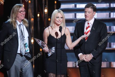 Stock Image of Chuck Ainlay, and from left, Miranda Lambert and Frank Liddell accept the album of the year award for Platinum at the 48th annual CMA Awards at the Bridgestone Arena, in Nashville, Tenn
