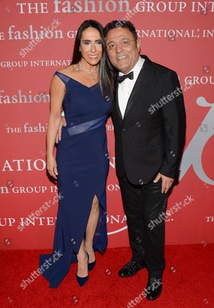 "Stock Photo of Designer Elie Tahari, right, and wife JoAnne Blessinger attend Fashion Group International's 31st Annual ""Night of Stars"" at Cipriani Wall Street on in New York"