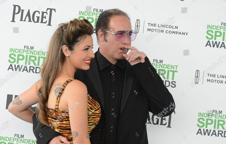 Valerie Vasquez, left, and Andrew Dice Clay arrive at the 2014 Film Independent Spirit Awards,, in Santa Monica, Calif