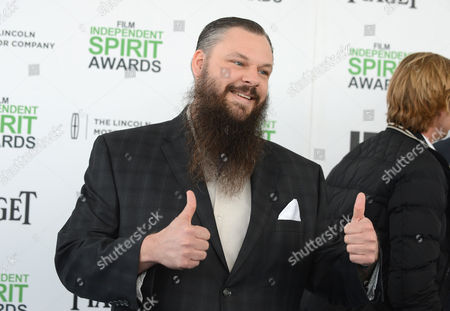 James M. Johnston arrives at the 2014 Film Independent Spirit Awards,, in Santa Monica, Calif