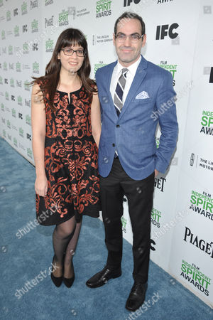 Cherie Saulter, left, and Chad Hartigan arrive at the 2014 Film Independent Spirit Awards,, in Santa Monica, Calif
