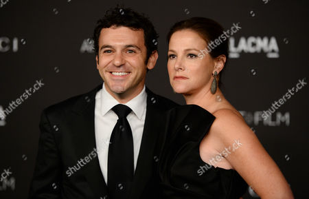 Stock Image of Fred Savage, left, and Jennifer Stone Savage arrive at the LACMA Art + Film Gala at LACMA, in Los Angeles