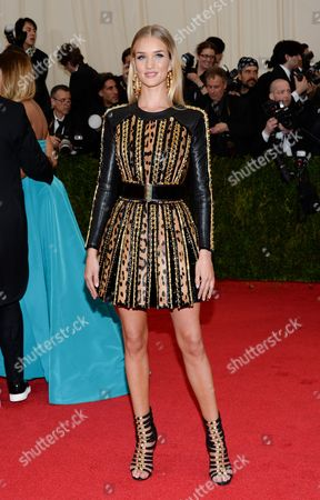 """Stock Image of Rosie Huntington-Whitley attends The Metropolitan Museum of Art's Costume Institute benefit gala celebrating """"Charles James: Beyond Fashion"""", in New York"""