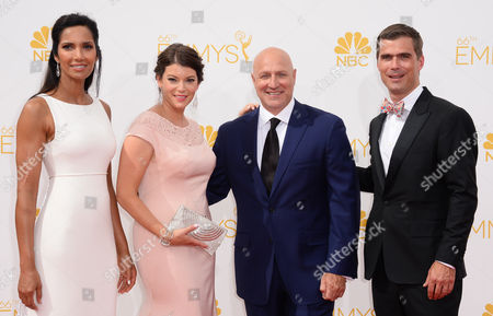 Stock Picture of Padma Lakshmi, from left, Gail Simmons, Tom Colicchio and Hugh Acheson arrive at the 66th Annual Primetime Emmy Awards at the Nokia Theatre L.A. Live, in Los Angeles